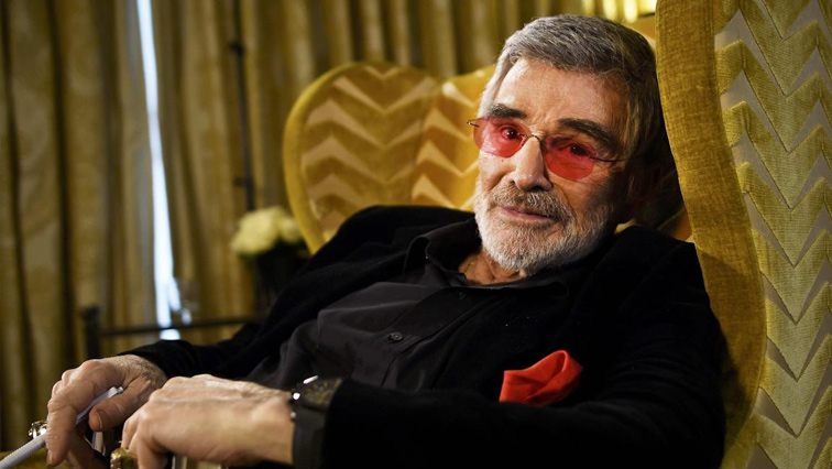 Burt Reynolds relaxed in a chair