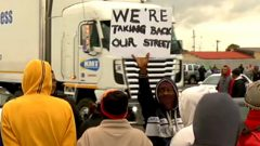 Protesters next to a truck