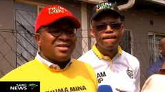 Fikile Mbalula wearing a red cap