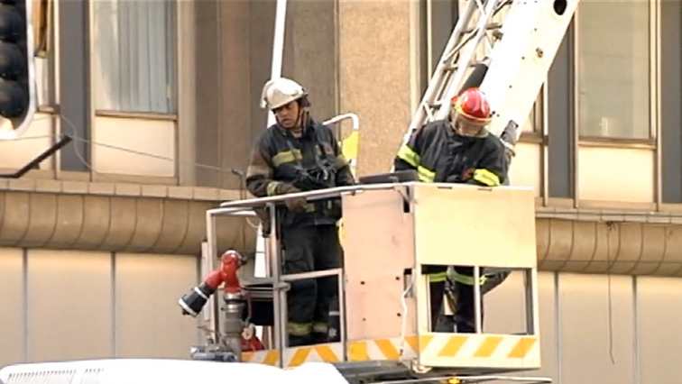 Firefighters on a crane