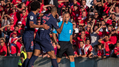 Kylian Mbappe pointing at the referee