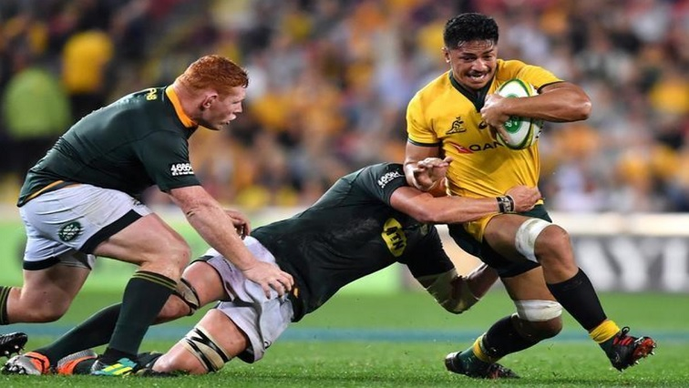 Australia's Pete Samu runs with the ball.