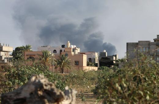 Smoke rises during heavy clashes between rival factions in Tripoli