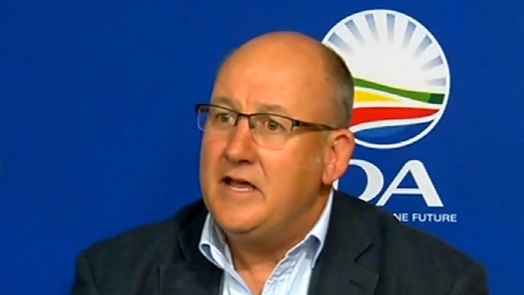 Athol Trollip in front of DA colours