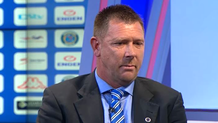 Eric Tinkler wearing a tie and suit
