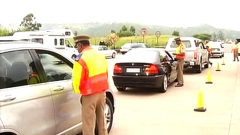 Officers and motorists at a roadblock