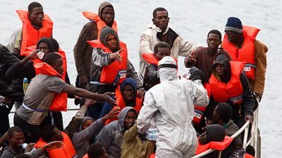 People wearing life jackets in a boat
