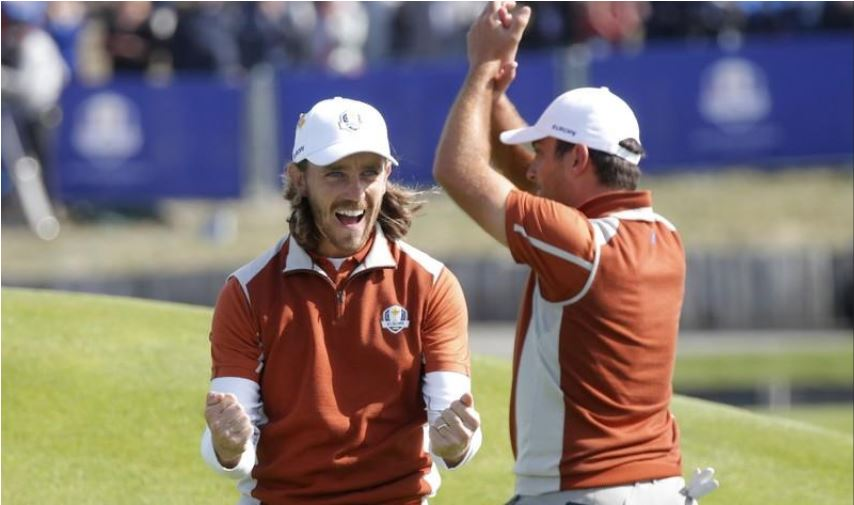 Tommy Fleetwood and Francesco Molinari celebrating on the field