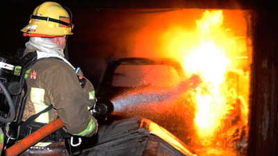 A fire-fighter extinguishing a fire