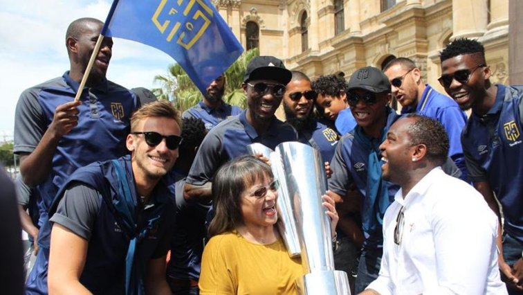 Patricia de Lille flanked by Cape Town City team members