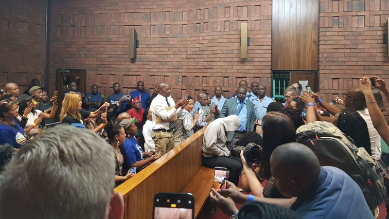 Media taking pictures of the accused