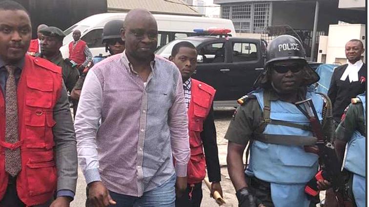 Peter Ayodele Fayose walking with an entourage