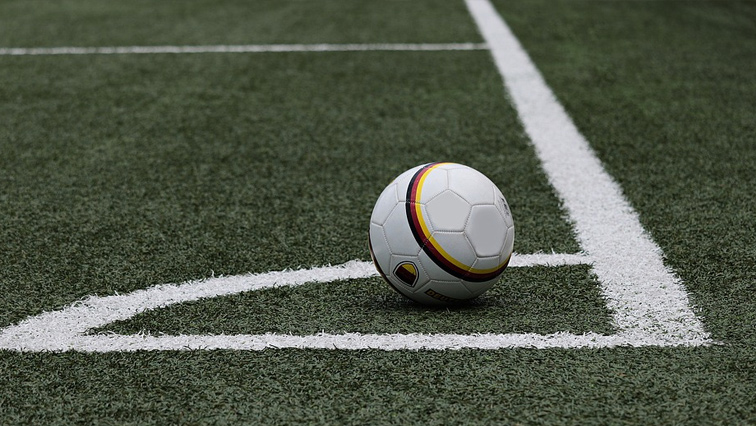 A soccer ball in a field.