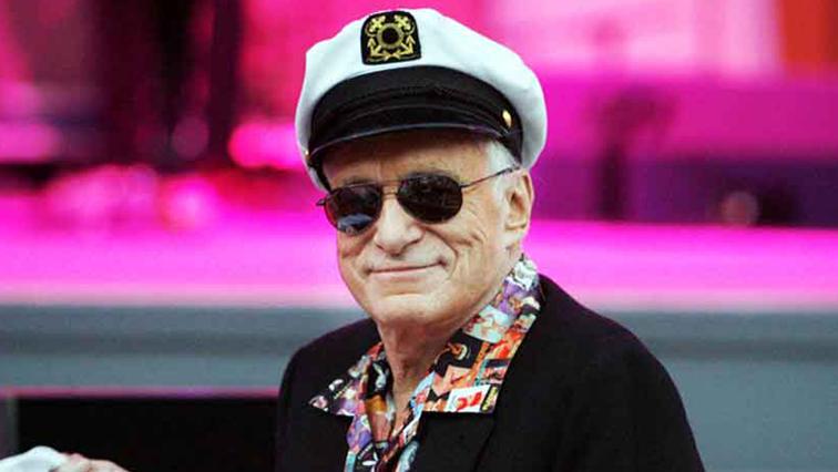 Hugh Hefner in cap and shades