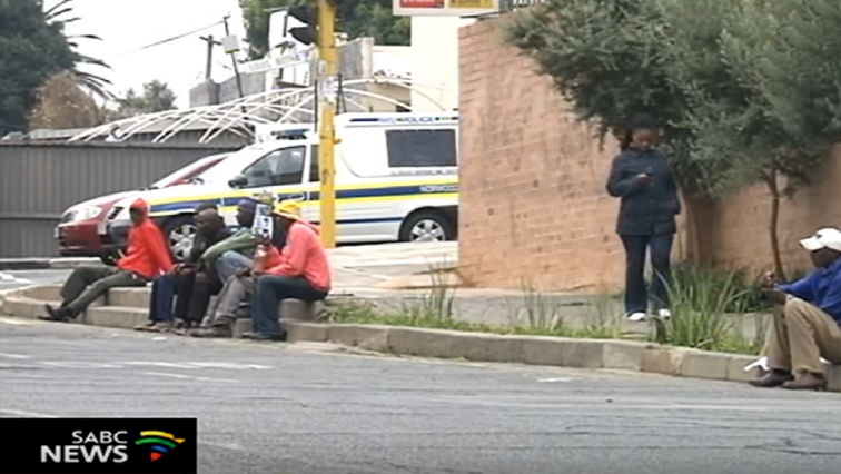 People sitting in a corner of the street