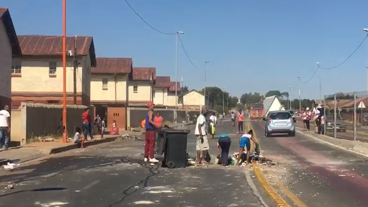 Residents lclearing up after protests
