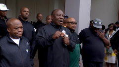 Ramaphosa and others on a walk