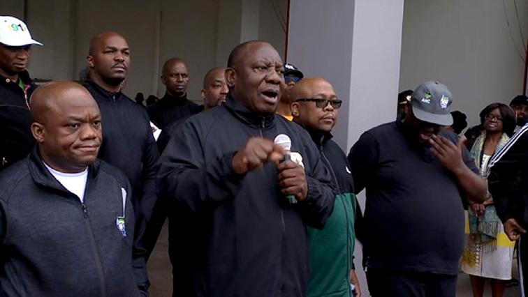 Ramaphosa and others on a walk