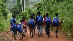 School kids carrying their solar backpacks