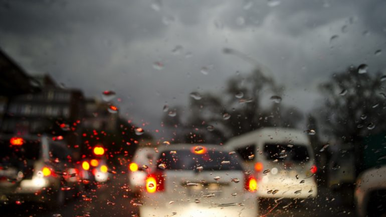 Cars driving in the rain