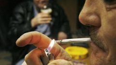 A smoker lights up