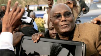 Atiku Abubakar getting into a car