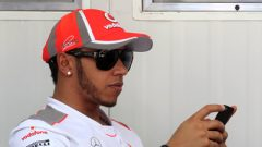 Lewis Hamilton on his mobile phone