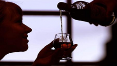 Woman drinking alcohol.