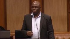Andries Tlouamma standing in parliament