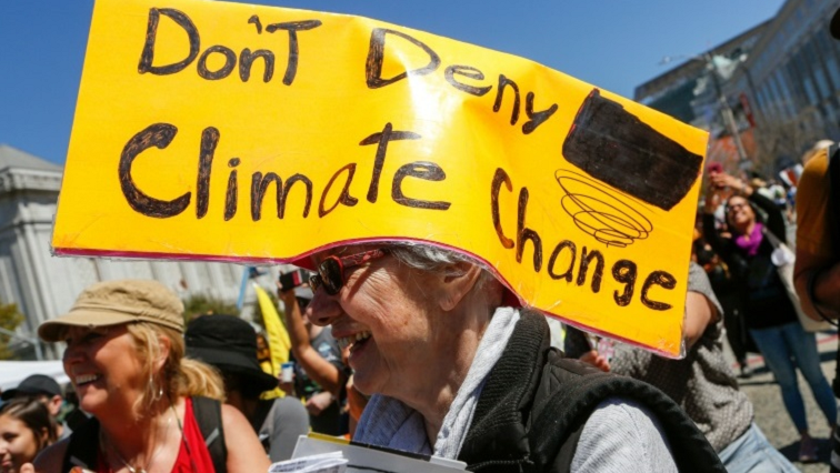 """Don't deny climate change"" sign"