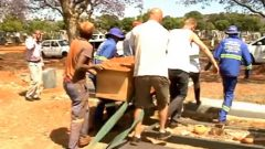 People carrying the coffin