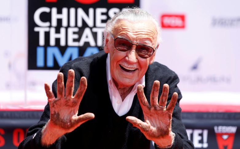 Stan Lee with his hands up