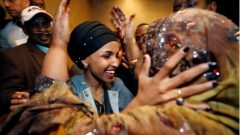 Ilhan Omar celebrates with other people