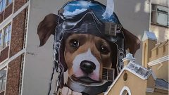 A drawing of a dog wearing aviator goggles