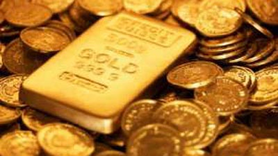 A gold bar and gold coins