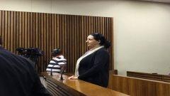 Vicki Momberg standing in court