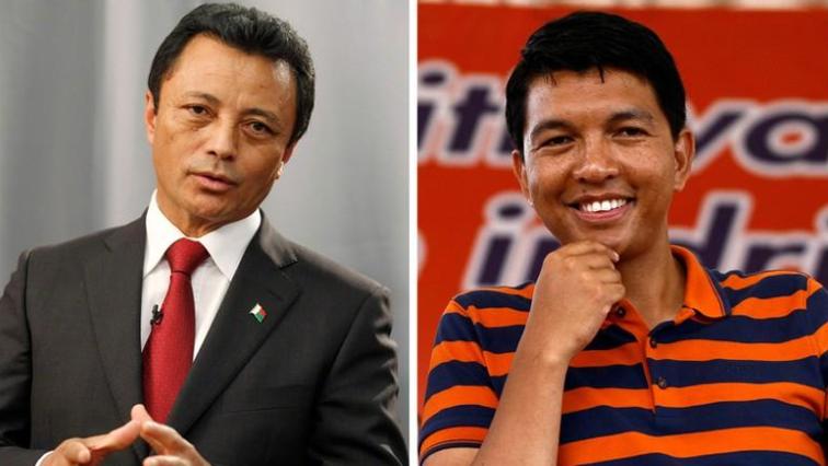 Former Madagascar presidents Marc Ravalomanana, left, and Andry Rajoelina