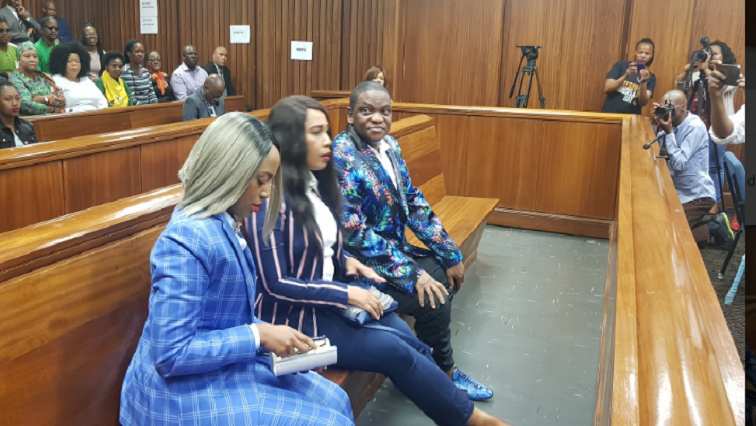 Three accused sitting in court