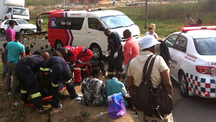 Paramedics helping a person