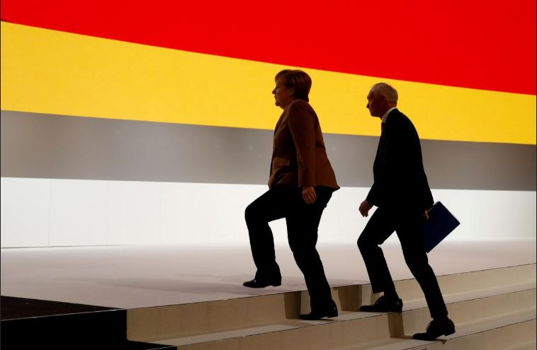 German Chancellor Angela Merkel tours the Christian Democratic Union (CDU) party congress venue in Hamburg.