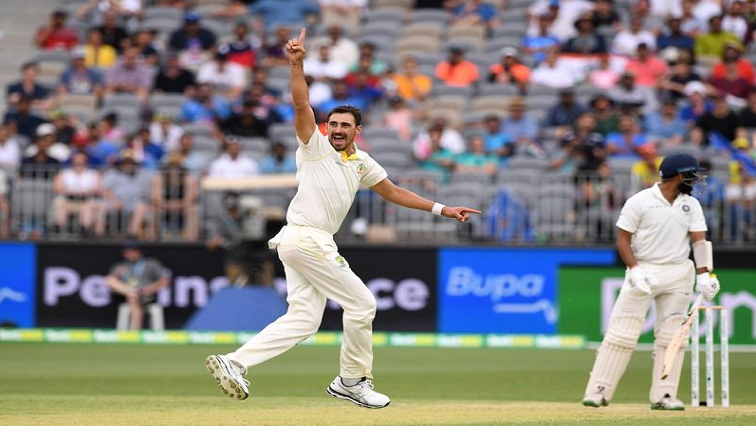 Australia's Mitchell Starc reacts after dismissing India's Cheteshwar Pujara.