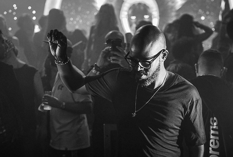 Black Coffee playing a set at a music festival.