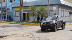 Police standing outside the bank where the attempted robbery took place.
