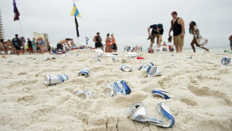 Cans of alcohol on the beach