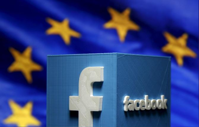 A 3D-printed Facebook logo is seen in front of the logo of the European Union in this picture illustration made in Zenica, Bosnia and Herzegovina.