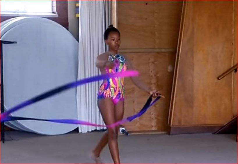 A gymnast with ribbons