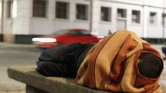 Person sleeping on the streets.