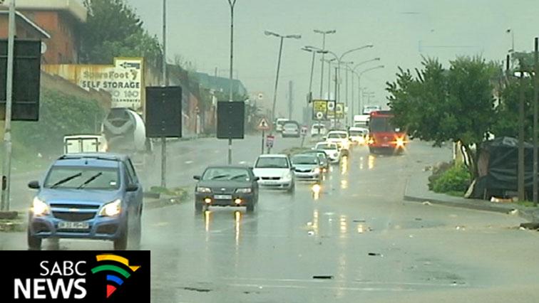 Cars driving through heavy rain