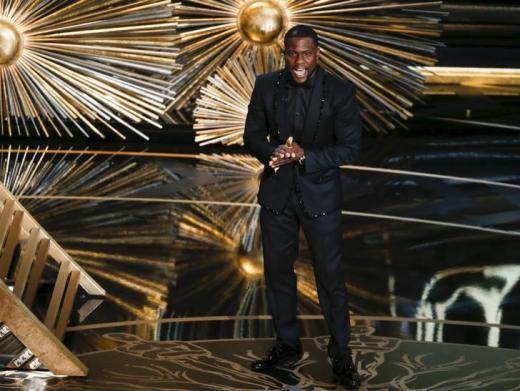 """Kevin Hart introduces a performance by The Weeknd, who was nominated for Best Original Song for """"Earned It"""" at the 88th Academy Awards in Hollywood."""