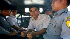 Journalist in handcuffs